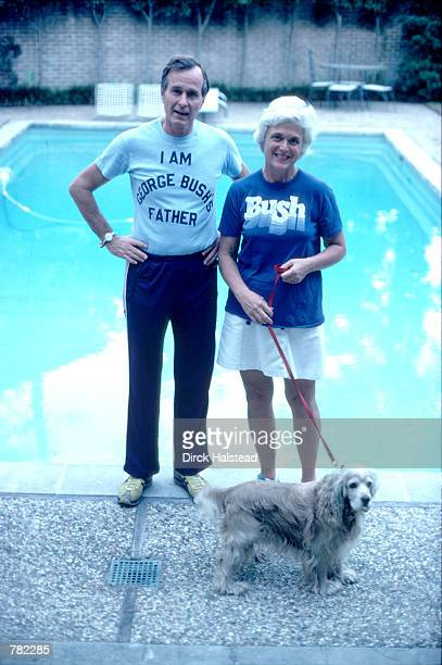 Republican Presidential candidate George Bush wearing a tshirt referencing his son George W Bush stands with his wife Barbara November 1978 in Texas...