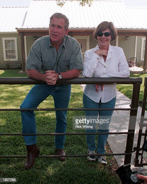 Republican presidential candidate George W Bush and his wife Laura speak to the press July 21 2000 at their ranch in Crawford Texas