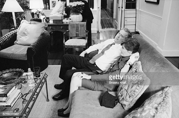 Republican presidential candidate George W Bush dozes off on the sofa with his his arm around his wife Laura as they await election results in the...