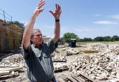 Republican presidential candidate George W Bush gives a tour to the media of his ranch and the new house he is having built 21 July 2000 in Crawford...