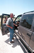 Republican presidential candidate George W Bush greets a dog in a truck while he meets with the press July 21 2000 at his ranch in Crawford Texas