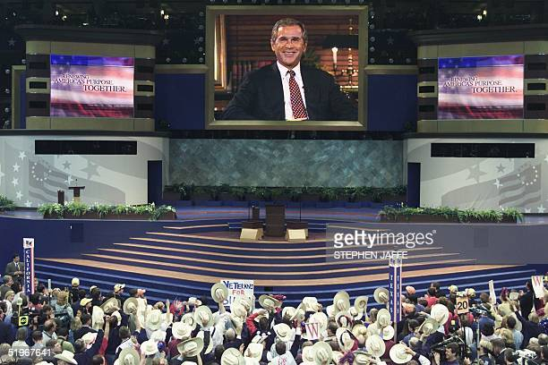 Republican Presidential Candidate George W Bush smiles from the big screen at the 2000 Republican National Convention at the First Union Center in...