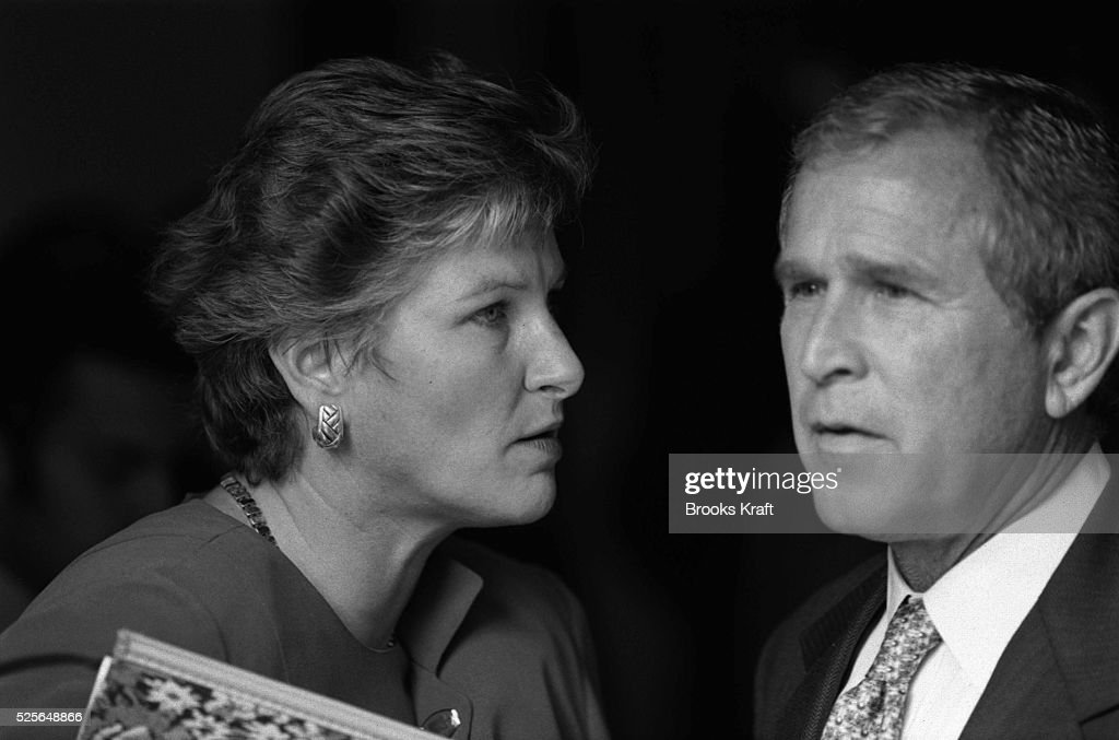 Republican presidential candidate George W Bush speaks with Karen Hughes his Campaign Communications Director Bush and Hughes were campaigning at the...