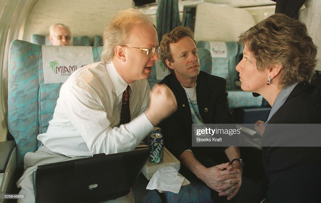 Republican presidential candidate George W Bush's campaign communications advisors converse on a plane Karl Rove Mark McKinnon and Karen Hughes...