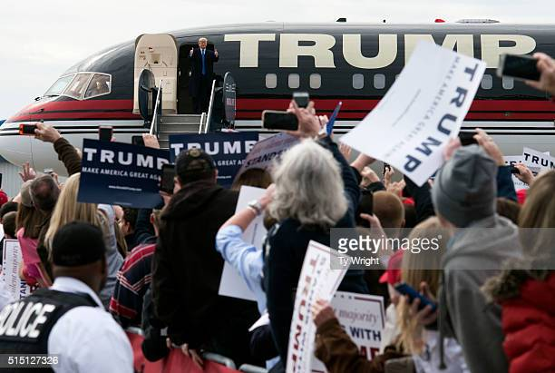 Republican Presidential candidate gives a thumbs up to the crowd walking off his plane at a campaign rally on March 12 2016 in Vandailia Ohio Today...
