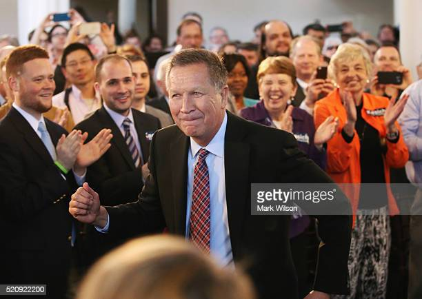 Republican presidential candidate Gov John Kasich dances to the music being played during a town hall style campaign stop at the Historic Savage Mill...