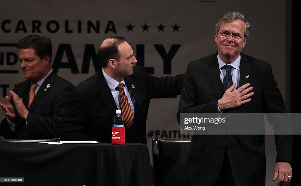Republican presidential candidate <a gi-track='captionPersonalityLinkClicked' href=/galleries/search?phrase=Jeb+Bush&family=editorial&specificpeople=171487 ng-click='$event.stopPropagation()'>Jeb Bush</a> (R) acknowledges the crowd after he participated in the South Carolina Faith and Family Presidential Forum with moderators South Carolina Attorney General Alan Wilson (2nd L) and Oran Smith (L) February 12, 2016 in Greenville, South Carolina. Four Republican candidates joined the forum as they continued to campaign in the Palmetto State.