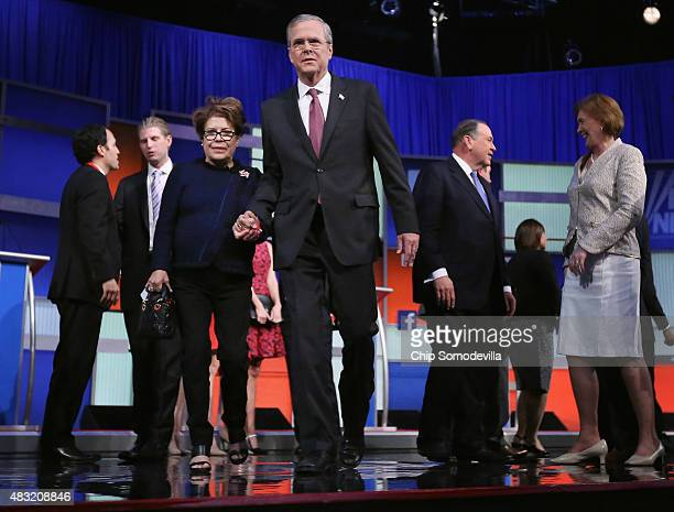 Republican presidential candidate Jeb Bush and his wife Columba Bush leave the stage after the first primetime presidential debate hosted by FOX News...