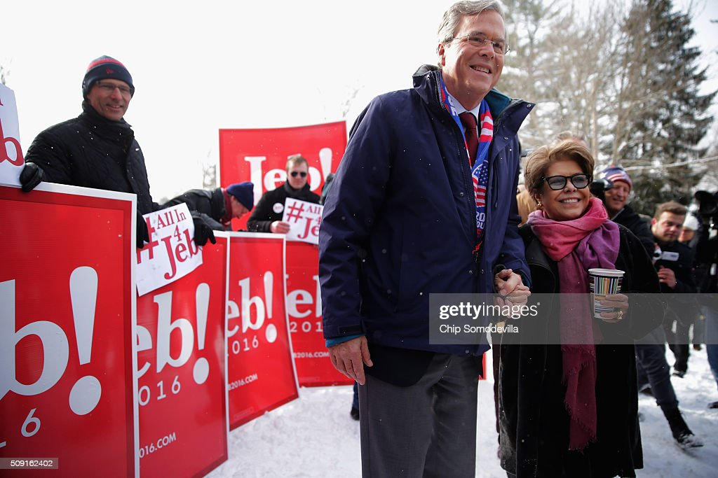Republican presidential candidate <a gi-track='captionPersonalityLinkClicked' href=/galleries/search?phrase=Jeb+Bush&family=editorial&specificpeople=171487 ng-click='$event.stopPropagation()'>Jeb Bush</a> and his wife <a gi-track='captionPersonalityLinkClicked' href=/galleries/search?phrase=Columba+Bush&family=editorial&specificpeople=971287 ng-click='$event.stopPropagation()'>Columba Bush</a> stop to pose for a photograph while thanking supporters outside the polling place at Webster School on primary day February 9, 2016 in Manchester, New Hampshire. Candidates from both parties are making last-minute attempts to swing voters to their side on the day of the 'First in the Nation' presidential primary.