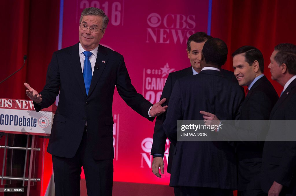 Republican presidential candidate Jeb Bush (L) and Marco Rubio (2nd R) gesture following the CBS News Republican Presidential Debate in Greenville, South Carolina, February 13, 2016. / AFP / JIM WATSON