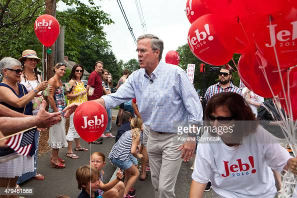 Republican Presidential candidate Jeb Bush greets supporters at the 4th of July Parade on July 4 2015 in Amherst New Hampshire Bush is a frontrunner...