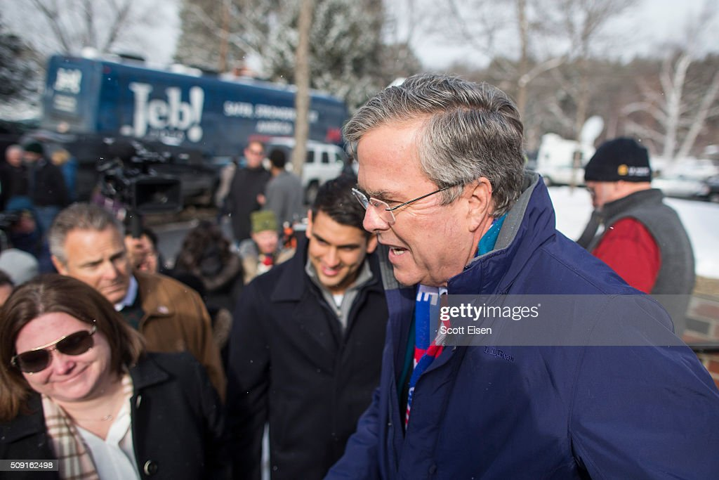 Republican presidential candidate Jeb Bush greets voters outside the polling place at Webster School on primary day February 9, 2016 in Manchester, New Hampshire. Candidates from both parties are making last-minute attempts to swing voters to their side on the day of the 'First in the Nation' presidential primary.