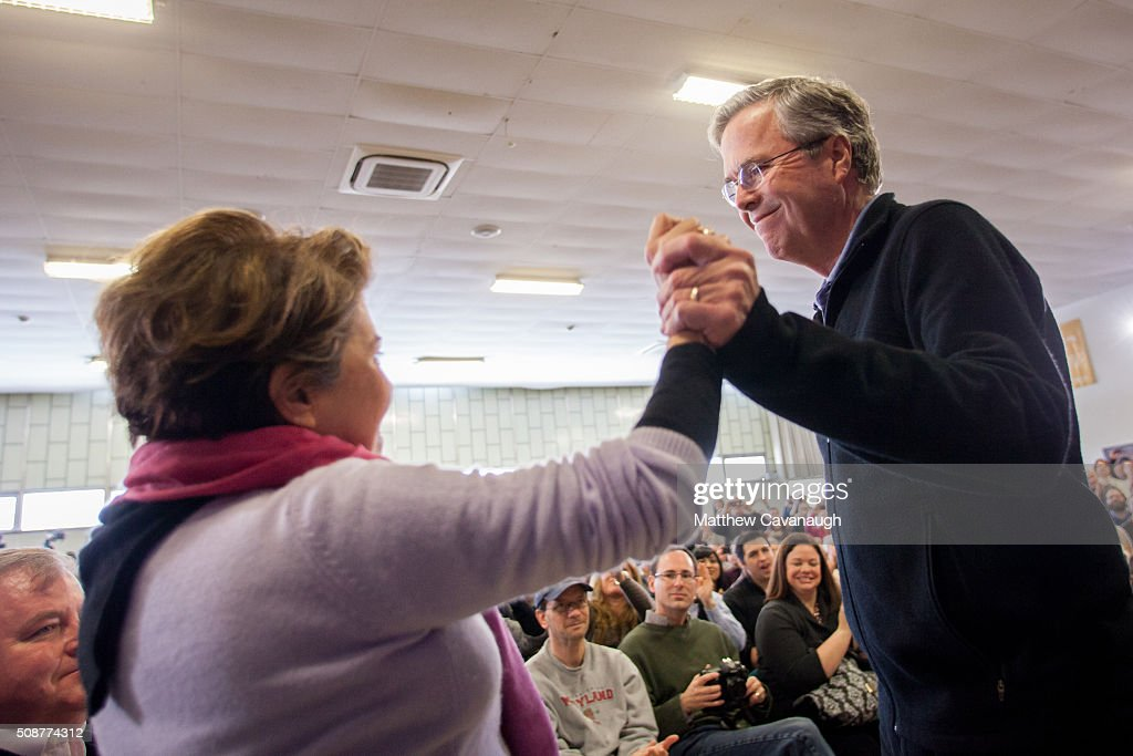 Republican presidential candidate <a gi-track='captionPersonalityLinkClicked' href=/galleries/search?phrase=Jeb+Bush&family=editorial&specificpeople=171487 ng-click='$event.stopPropagation()'>Jeb Bush</a> holds the hand of his wife Columba at a town hall style meeting on February 6, 2016 at the McKelvie Intermediate School in Bedford, New Hampshire. Bush is campaigning in the lead up to the The New Hampshire primary, February 9.