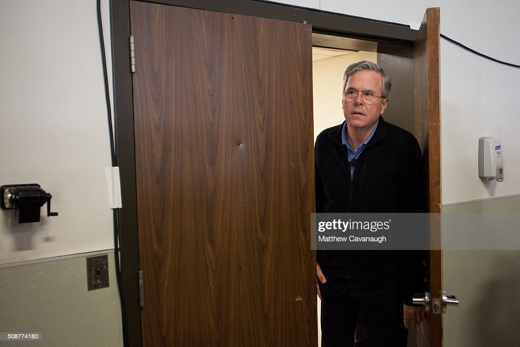 Republican presidential candidate <a gi-track='captionPersonalityLinkClicked' href=/galleries/search?phrase=Jeb+Bush&family=editorial&specificpeople=171487 ng-click='$event.stopPropagation()'>Jeb Bush</a> looks out from back stagestage as he is introduced at a town hall style meeting on February 6, 2016 at the McKelvie Intermediate School in Bedford, New Hampshire. Bush is campaigning in the lead up to the The New Hampshire primary, February 9.