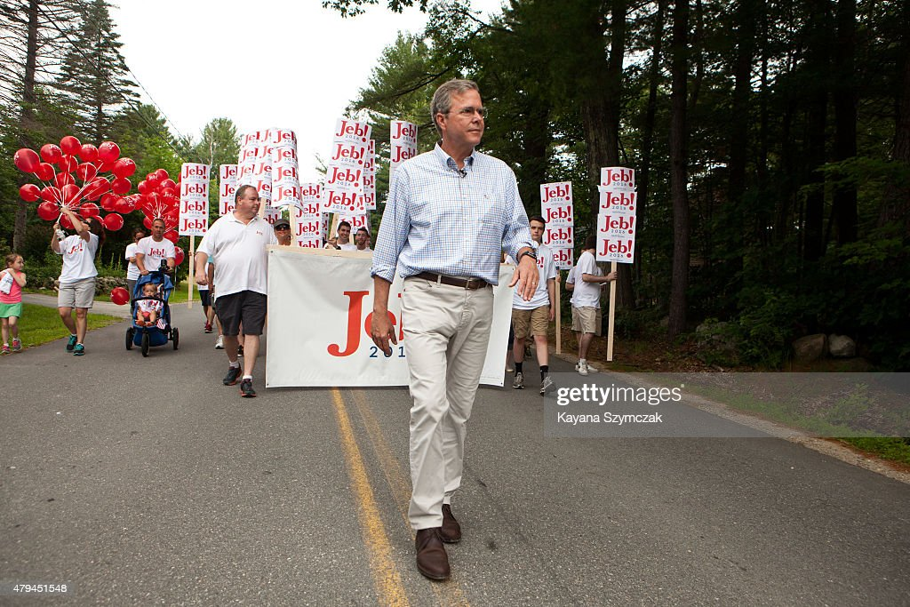 Republican Presidential candidate Jeb Bush marches in the 4th of July Parade on July 4 2015 in Amherst New Hampshire Bush is a frontrunner in the...