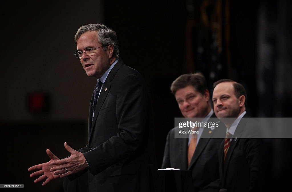 Republican presidential candidate <a gi-track='captionPersonalityLinkClicked' href=/galleries/search?phrase=Jeb+Bush&family=editorial&specificpeople=171487 ng-click='$event.stopPropagation()'>Jeb Bush</a> (L) participates in the South Carolina Faith and Family Presidential Forum as moderators, South Carolina Attorney General Alan Wilson (R) and Oran Smith (2nd L), listen February 12, 2016 in Greenville, South Carolina. Four Republican candidates joined the forum as they continued to campaign in the Palmetto State.