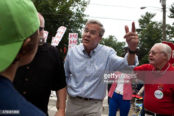 Republican Presidential candidate Jeb Bush responds to a climate change activist who confronted him with questions at the 4th of July Parade in...