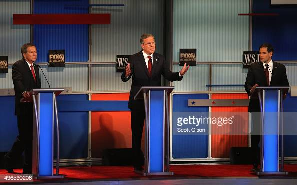 Republican presidential candidate Jeb Bush speaks while Gov John Kasich and Sen Marco Rubio look on at the Republican Presidential Debate sponsored...