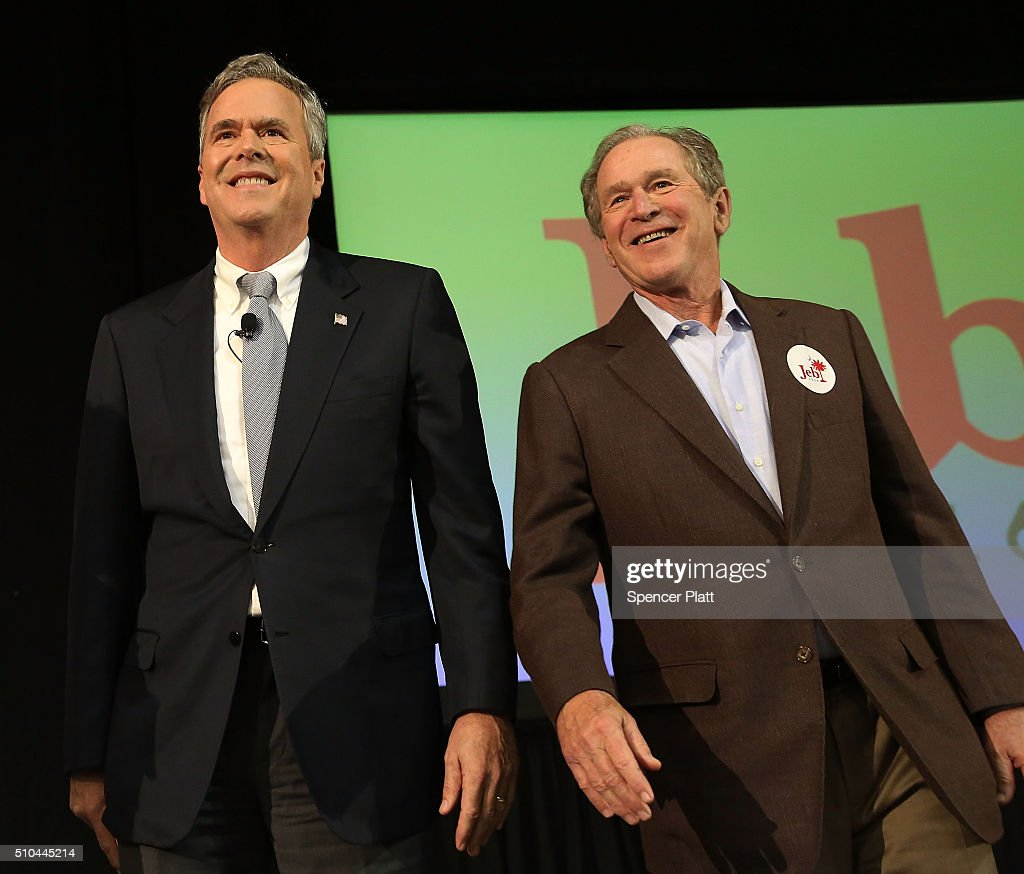 Republican presidential candidate Jeb Bush stands with his brother former President George W Bush at a campaign rally on February 15 2016 in North...