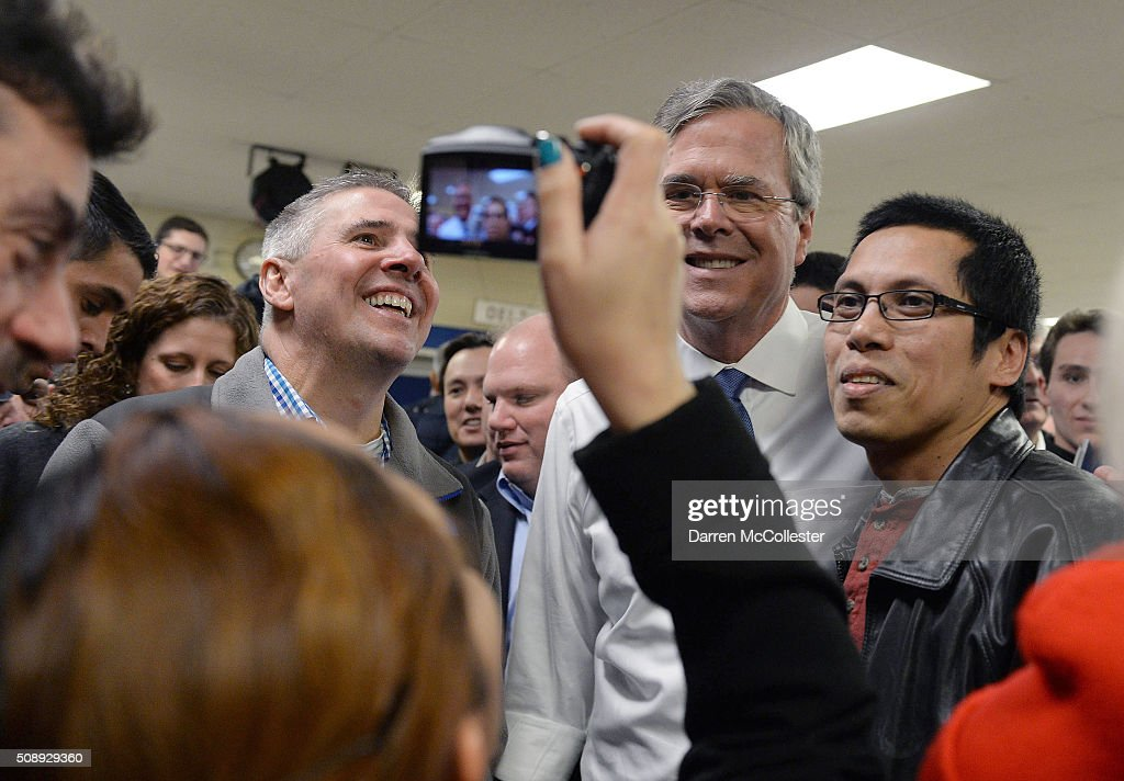 Republican Presidential candidate Jeb Bush takes pictures with people following a town hall at Woodbury School February 7, 2016 in Salem, New Hampshire. Candidates are in a last push for votes ahead of the first in the nation primary on February 9.