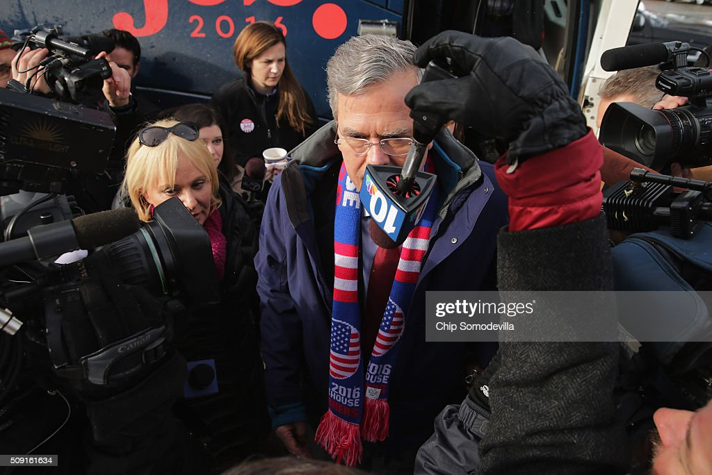 Republican presidential candidate <a gi-track='captionPersonalityLinkClicked' href=/galleries/search?phrase=Jeb+Bush&family=editorial&specificpeople=171487 ng-click='$event.stopPropagation()'>Jeb Bush</a> wades into a crowd of television cameras after stepping off his campaign bus outside the polling place at Webster School on primary day February 9, 2016 in Manchester, New Hampshire. Candidates from both parties are making last-minute attempts to swing voters to their side on the day of the 'First in the Nation' presidential primary.
