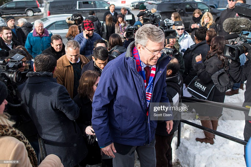 Republican presidential candidate Jeb Bush walks up steps to greet voters outside the polling place at Webster School on primary day February 9, 2016 in Manchester, New Hampshire. Candidates from both parties are making last-minute attempts to swing voters to their side on the day of the 'First in the Nation' presidential primary.