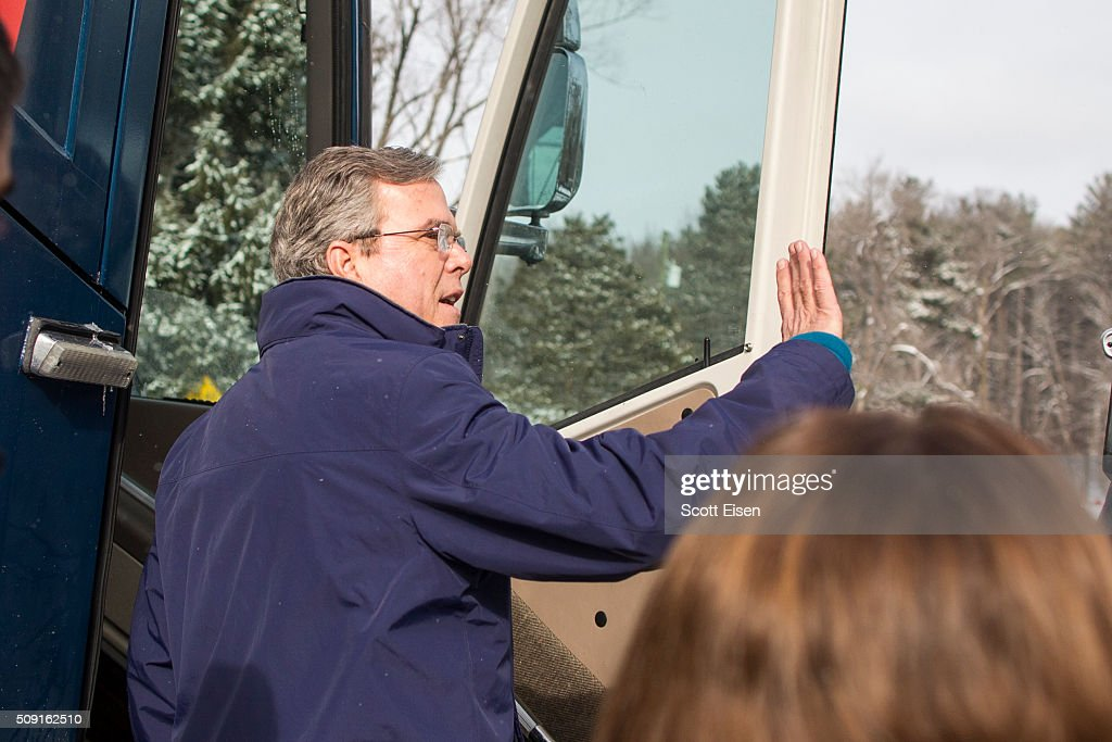 Republican presidential candidate Jeb Bush waves to voters outside the polling place at Webster School on primary day February 9, 2016 in Manchester, New Hampshire. Candidates from both parties are making last-minute attempts to swing voters to their side on the day of the 'First in the Nation' presidential primary.