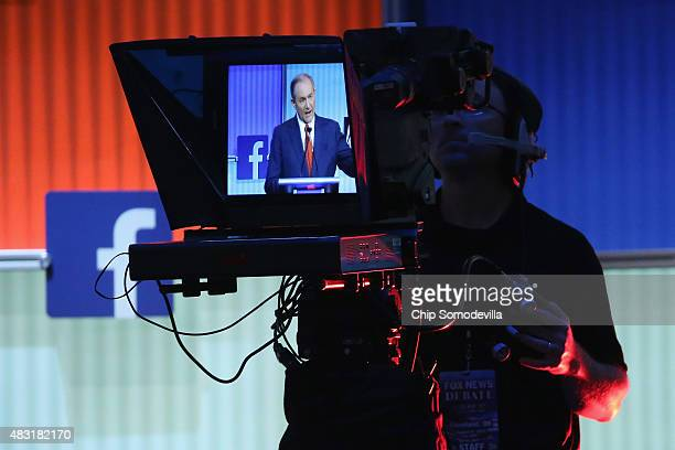 Republican presidential candidate Jim Gilmore appears on a teleprompter as he participates in a presidential predebate forum hosted by FOX News and...
