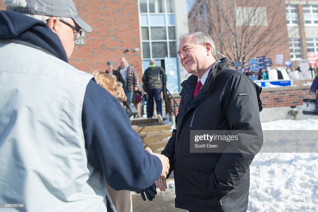 Republican presidential candidate <a gi-track='captionPersonalityLinkClicked' href=/galleries/search?phrase=Jim+Gilmore+-+Politician&family=editorial&specificpeople=14903215 ng-click='$event.stopPropagation()'>Jim Gilmore</a> greets voters outside the polling place at Webster School on primary day February 9, 2016 in Manchester, New Hampshire. Candidates from both parties are making last-minute attempts to swing voters to their side on the day of the 'First in the Nation' presidential primary.