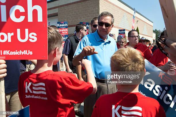 Republican presidential candidate John Kasich greets supporters at the Labor Day parade on September 7 2015 in Milford New Hampshire Kasich buoyed by...