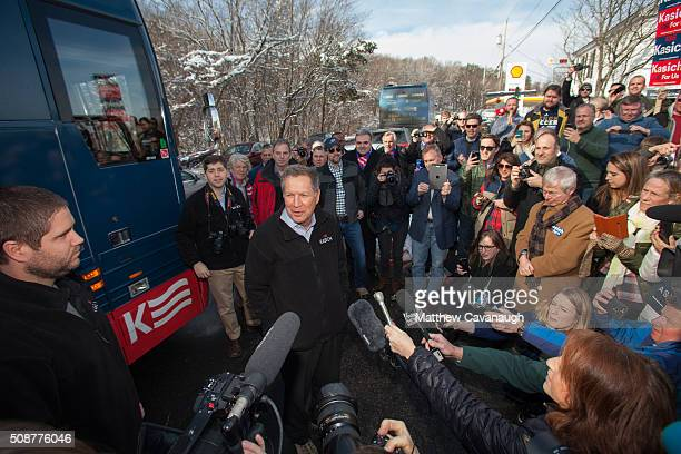Republican presidential candidate John Kasich speaks to campaign workers and volunteers prior to their door to door campaign effort on February 6...