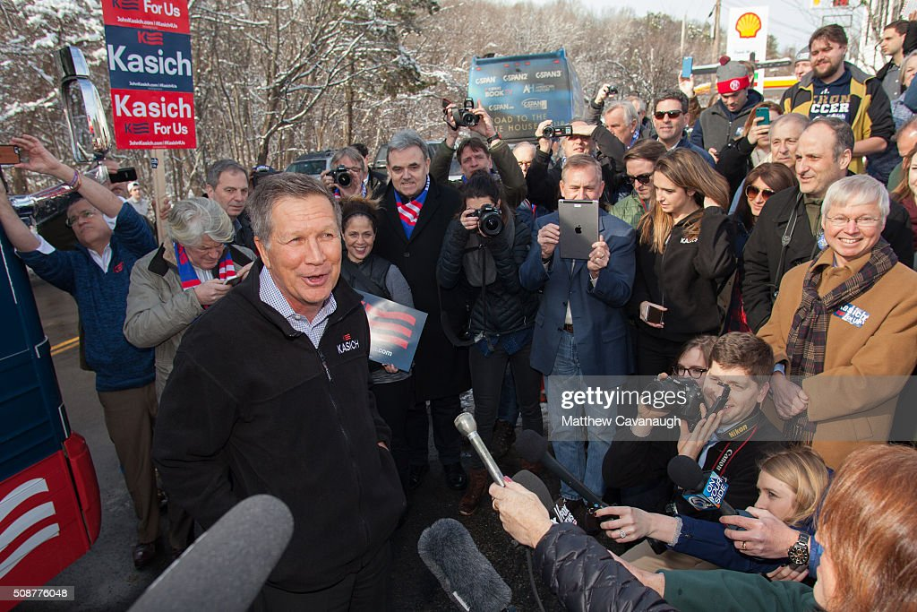 Republican presidential candidate <a gi-track='captionPersonalityLinkClicked' href=/galleries/search?phrase=John+Kasich&family=editorial&specificpeople=1315571 ng-click='$event.stopPropagation()'>John Kasich</a> speaks to campaign workers and volunteers prior to their door to door campaign effort on February 6, 2016 outside his New Hampshire campaign headquarters in Manchester, New Hampshire. Kasich is campaigning in the lead up to the The New Hampshire primary, February 9.