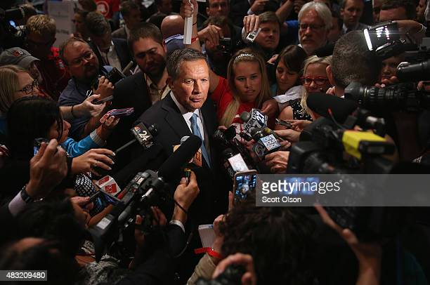 Republican presidential candidate John Kasich talks to reporters in the 'Spin Alley' after the first primetime presidential debate hosted by FOX News...