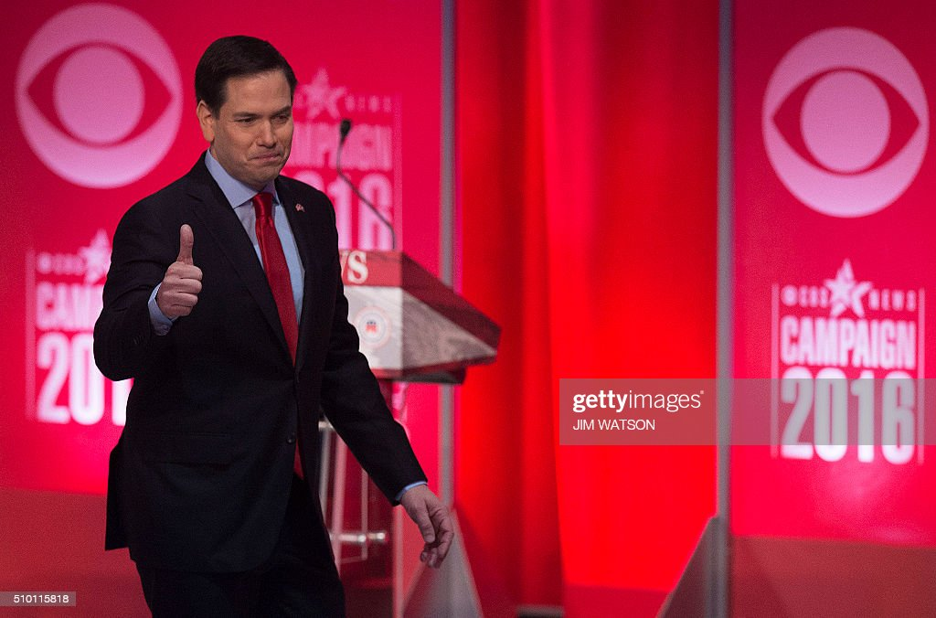 Republican presidential candidate Marco Rubio gives a thumbs up after the CBS News Republican Presidential Debate in Greenville, South Carolina, February 13, 2016. / AFP / JIM WATSON