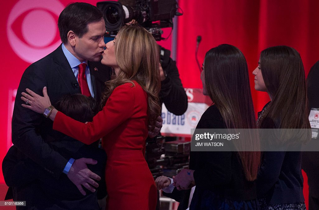 Republican presidential candidate Marco Rubio (L) kisses his wife Jeanette Dousdebes Rubio following the CBS News Republican Presidential Debate in Greenville, South Carolina, February 13, 2016. / AFP / JIM WATSON