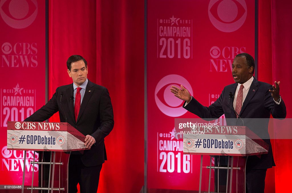Republican presidential candidate Marco Rubio (L) looks on as Ben Carson speaks during the CBS News Republican Presidential Debate in Greenville, South Carolina, February 13, 2016. / AFP / JIM WATSON