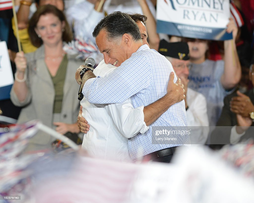 Republican presidential candidate <a gi-track='captionPersonalityLinkClicked' href=/galleries/search?phrase=Mitt+Romney&family=editorial&specificpeople=207106 ng-click='$event.stopPropagation()'>Mitt Romney</a> and his son <a gi-track='captionPersonalityLinkClicked' href=/galleries/search?phrase=Craig+Romney&family=editorial&specificpeople=4453864 ng-click='$event.stopPropagation()'>Craig Romney</a> attend Juntos Con Romney Rally at Miami-Dade County Fair and Exhibition on September 19, 2012 in Miami, Florida.