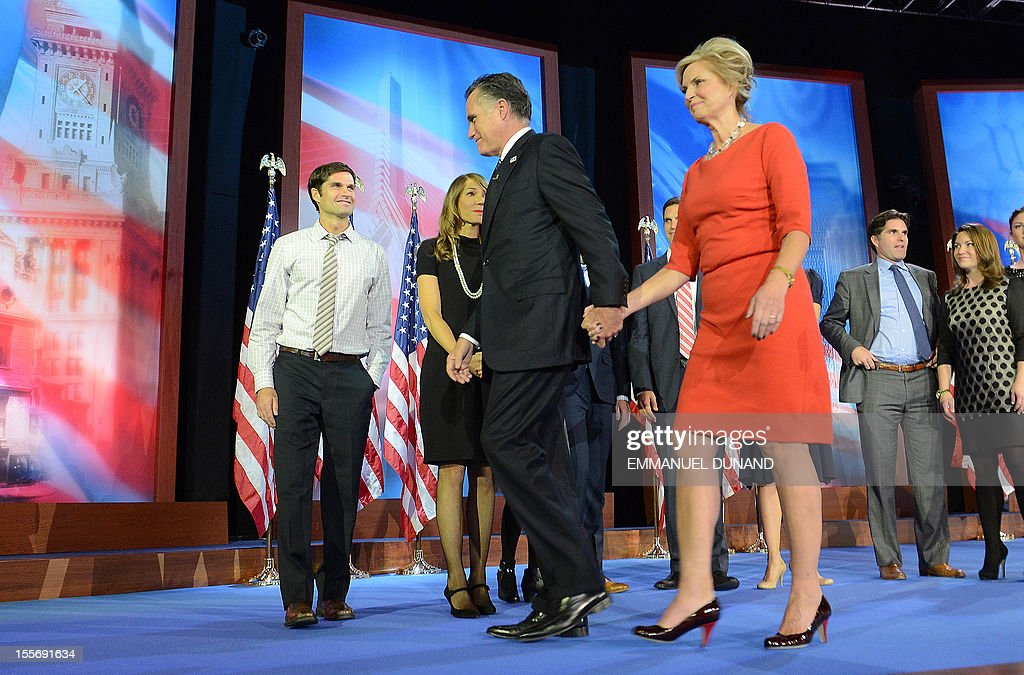 US Republican presidential candidate Mitt Romney and his wife Ann leave the stage on election night November 7, 2012 in Boston. President Barack Obama swept to re-election Tuesday, forging history again by transcending a slow economic recovery and the high unemployment which haunted his first term to beat Republican Mitt Romney.