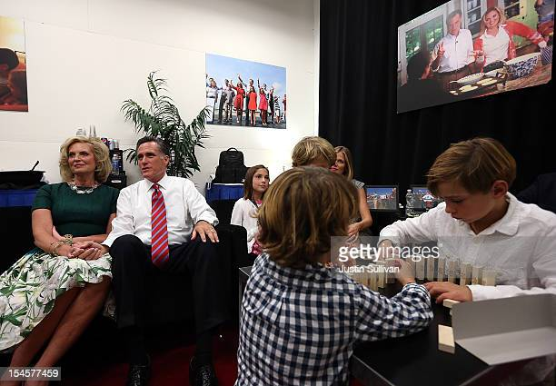 Republican presidential candidate Mitt Romney and his wife Ann Romney sit backstage with members of their family before the start of a debate with US...