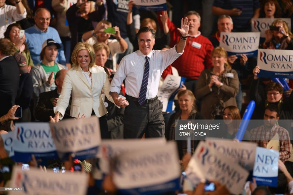 US Republican Presidential candidate Mitt Romney (C) and his wife Ann Romney (L) at a rally late November 5, 2012 at the Verizon Wireless Arena in Manchester, New Hampshire. AFP PHOTO/Stan HONDA