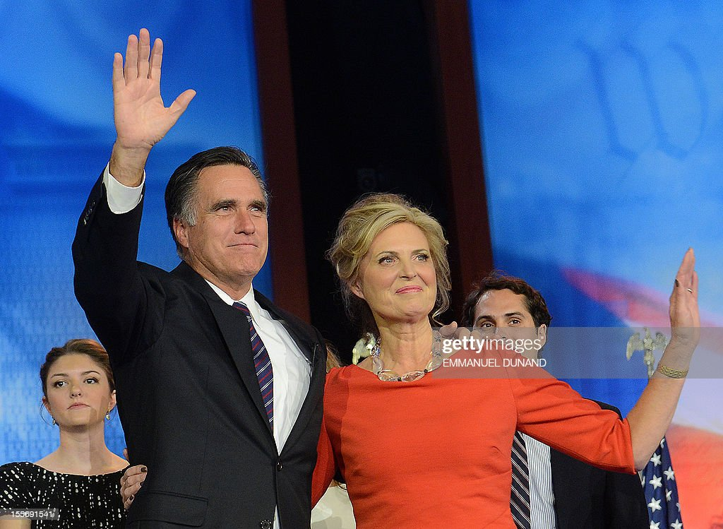 US Republican presidential candidate Mitt Romney and his wife Ann wave after Romney conceded defeat to President Barack Obama on November 7, 2012 in Boston. Obama swept to re-election, forging history again by transcending a slow economic recovery and the high unemployment which haunted his first term to beat Republican Mitt Romney.