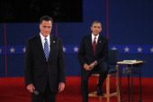 Republican presidential candidate Mitt Romney and US President Barack Obama listen as moderator Candy Crowley of CNN asks a question during a town...