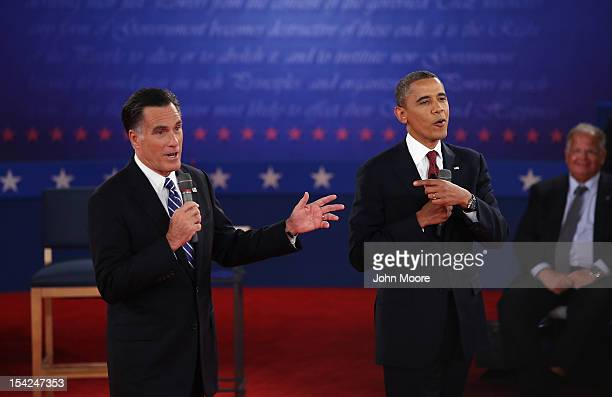 Republican presidential candidate Mitt Romney and US President Barack Obama talk over each other as they answer questions during a town hall style...