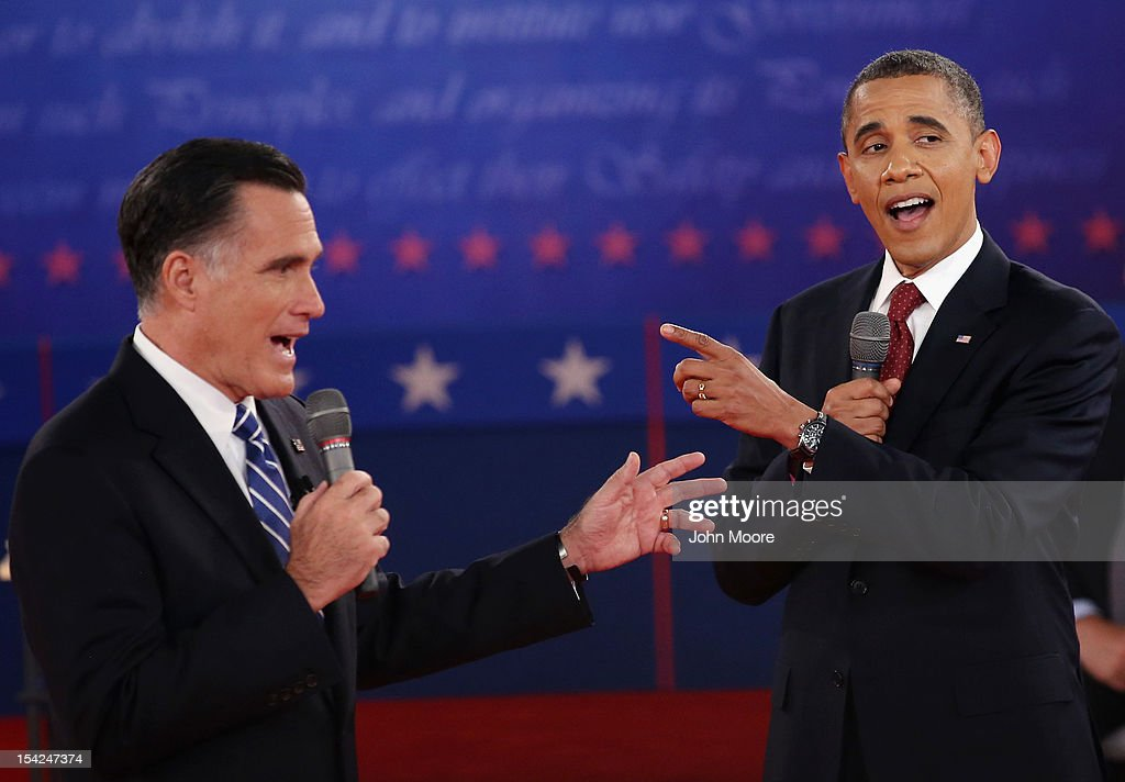Republican presidential candidate <a gi-track='captionPersonalityLinkClicked' href=/galleries/search?phrase=Mitt+Romney&family=editorial&specificpeople=207106 ng-click='$event.stopPropagation()'>Mitt Romney</a> (L) and U.S. President <a gi-track='captionPersonalityLinkClicked' href=/galleries/search?phrase=Barack+Obama&family=editorial&specificpeople=203260 ng-click='$event.stopPropagation()'>Barack Obama</a> talk over each other as they answer questions during a town hall style debate at Hofstra University October 16, 2012 in Hempstead, New York. During the second of three presidential debates, the candidates fielded questions from audience members on a wide variety of issues.