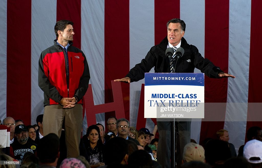US Republican presidential candidate Mitt Romney (R) and US Republican vice presidential candidate Paul Ryan (L) deliver remarks during a victory rally in Lancaster, Ohio, October 12, 2012. AFP PHOTO/Jim WATSON