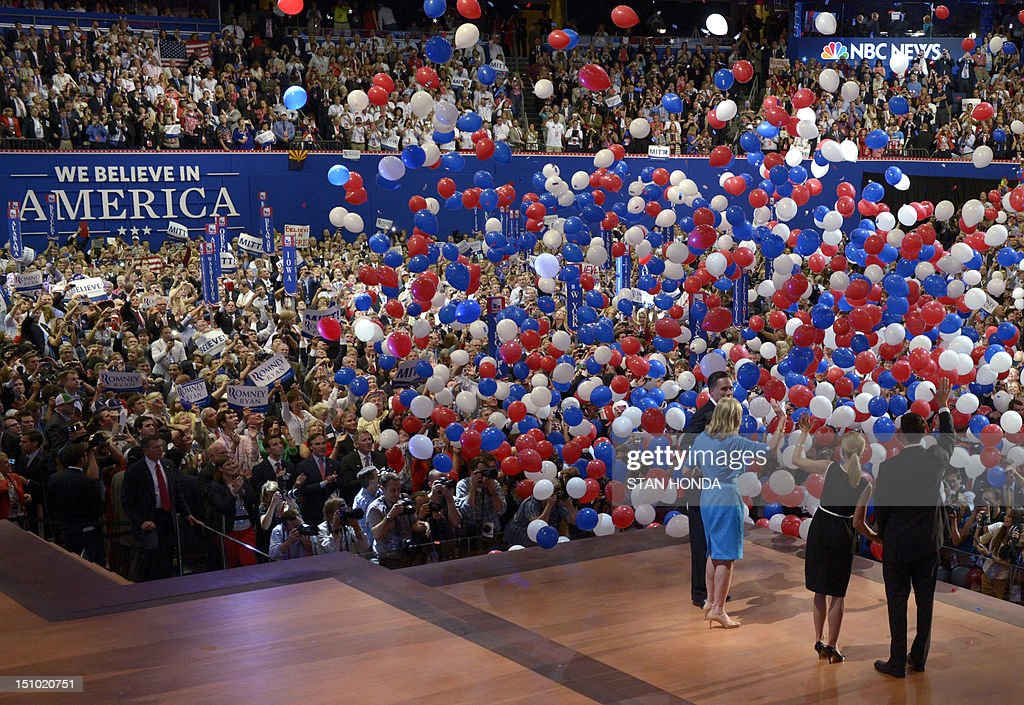 Republican presidential candidate Mitt Romney and wife Ann and vice presidential nominee Paul Ryan and wife Janna wave to the crowd following...