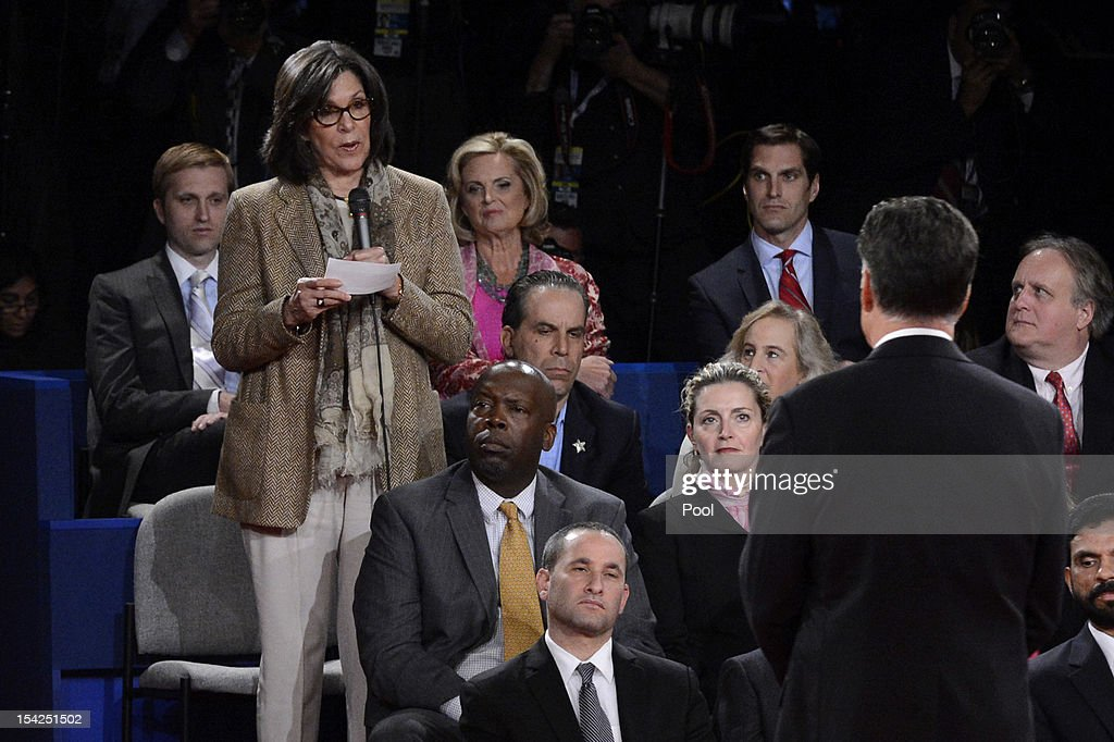 Republican presidential candidate <a gi-track='captionPersonalityLinkClicked' href=/galleries/search?phrase=Mitt+Romney&family=editorial&specificpeople=207106 ng-click='$event.stopPropagation()'>Mitt Romney</a> (R) answers a question from audience member Nina Gonzalez during a town hall style debate at Hofstra University October 16, 2012 in Hempstead, New York. During the second of three presidential debates, the candidates fielded questions from audience members on a wide variety of issues.