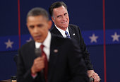 Republican presidential candidate Mitt Romney as US President Barack Obama answers a question during a town hall style debate at Hofstra University...