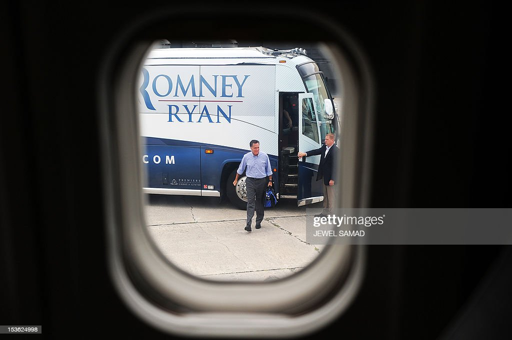 US Republican presidential candidate Mitt Romney boards his campaign plane on October 7, 2012 in Palm Beach, Florida. AFP PHOTO/Jewel Samad