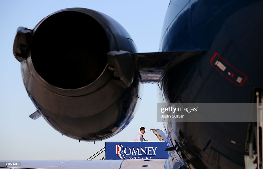 Republican presidential candidate <a gi-track='captionPersonalityLinkClicked' href=/galleries/search?phrase=Mitt+Romney&family=editorial&specificpeople=207106 ng-click='$event.stopPropagation()'>Mitt Romney</a> boards his campaign plane on October 23, 2012 in West Palm Beach, Florida. A day after the final Presidential debate, <a gi-track='captionPersonalityLinkClicked' href=/galleries/search?phrase=Mitt+Romney&family=editorial&specificpeople=207106 ng-click='$event.stopPropagation()'>Mitt Romney</a> is campaigning in Nevada and Colorado.